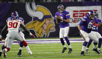 Minnesota Vikings quarterback Sam Bradford, center, throws a pass during the first half of an NFL football game against the New York Giants Monday, Oct. 3, 2016, in Minneapolis. (AP Photo/Andy Clayton-King)