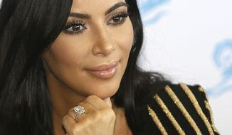 In this June 24, 2015 file photo, American TV personality Kim Kardashian attends the Cannes Lions 2015, International Advertising Festival in Cannes, southern France. Armed robbers forced their way into a private Paris residence where Kardashian West was staying, and stole more than $10 million worth of jewelry, police officials said Monday, Oct. 3, 2016. They said five assailants, who are still at large, stole a jewelry box containing valuables worth 6 million euros ($6.7 million) as well as a ring worth 4 million euros ($4.5 million). (AP Photo/Lionel Cironneau, File)