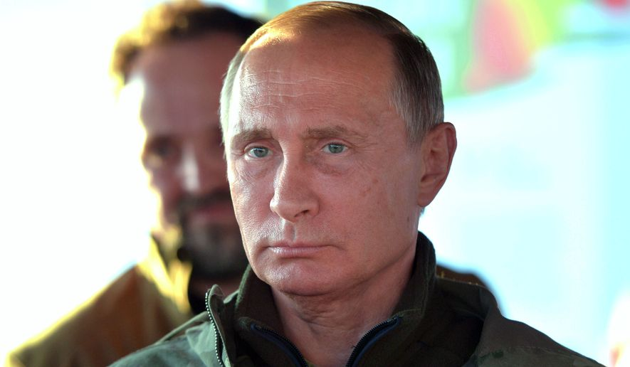"Russian President Vladimir Putin's decree cited Washington's ""unfriendly actions"" and the U.S. inability to fulfill its obligations under the 2000 deal as reasons for the move. (Associated Press)"