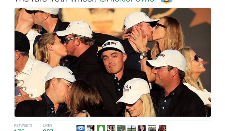 An unattached Rickie Fowler, Ryder Cup co-champion, shown shrugging as fellow team members lock lips with their significant others. Screen capture from Twitter.
