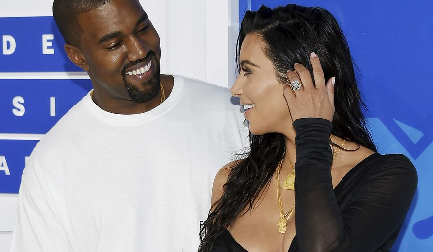 FILE - In this Aug. 28, 2016 file photo, Kanye West, left, and Kim Kardashian West arrive at the MTV Video Music Awards in New York. Armed robbers forced their way into a private Paris residence early Monday, Oct. 3, where Kim Kardashian West was staying and tied her up, police officials said. They said five assailants, who are still at large, stole a jewelry box containing valuables worth 6 million euros ($6.7 million) as well as a ring worth 4 million euros ($4.5 million.) (Photo by Evan Agostini/Invision/AP, File)