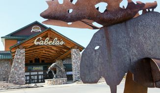 FILE - In this Wednesday, Feb. 17, 2016, file photo, statues of wildlife adorn the entrance to a Cabela's store in LaVista, Neb. Outdoor gear giants Bass Pro and Cabela's will combine in a $4.5 billion deal announced Monday, Oct. 3, 2016. (AP Photo/Nati Harnik, File)