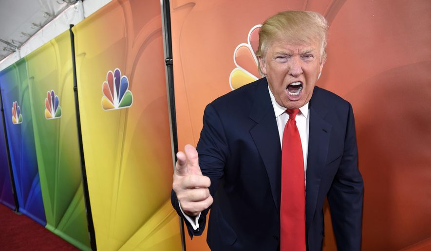 "In this Jan. 16, 2015, file photo, Donald Trump, host of the reality television series ""The Celebrity Apprentice,"" poses for photographers at the NBC 2015 Winter TCA Press Tour in Pasadena, Calif. (Photo by Chris Pizzello/Invision/AP, File)"