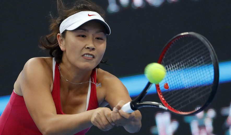 Peng Shuai of China hits a return shot against Venus Williams of the United States during their women's singles match at the China Open tennis tournament at the National Tennis Stadium in Beijing, Monday, Oct. 3, 2016. (AP Photo/Andy Wong)