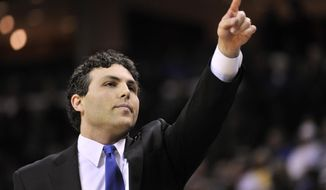 In this Thursday, Feb. 25, 2016, photo, then Memphis head coach Josh Pastner gestures in the first half of an NCAA college basketball game in Memphis, Tenn. Pastner, a former Memphis coach, opened practice Monday, Oct. 3, 2016, with his new team, leading a Georgia Tech program that hasn't made the NCAA tournament since 2010 and lost nearly all of its scoring punch from Brian Gregory's final team. (AP Photo/Brandon Dill)
