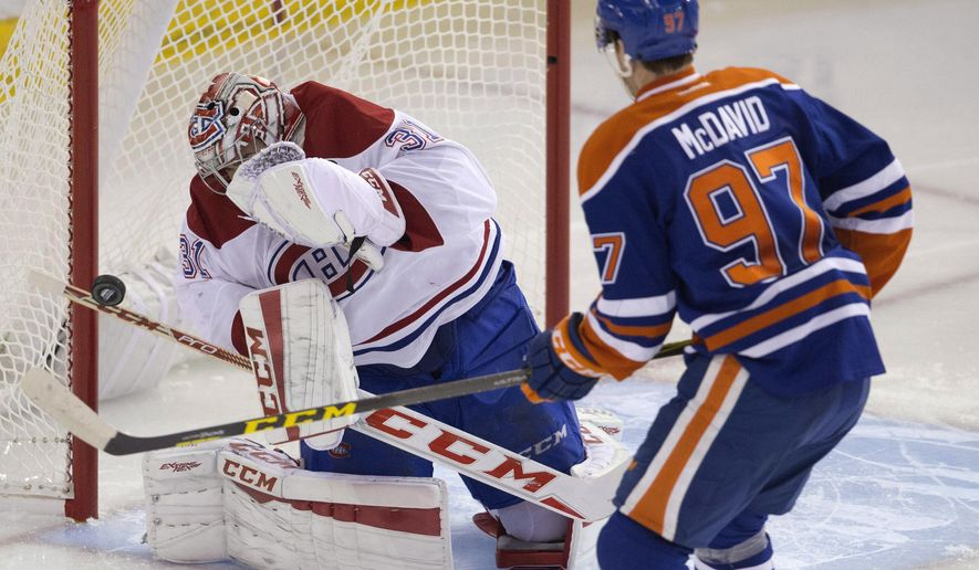 FILE - In an Oct. 29, 2015 file photo, Montreal Canadiens goalie Carey Price (31) makes the save on Edmonton Oilers' Connor McDavid (97) during second period NHL action in Edmonton, Alberta. The biggest reason the Canadiens are contenders again is all-world goaltender Price, back after missing most of the 2016 season with a knee injury. (Jason Franson/The Canadian Press via AP, File)