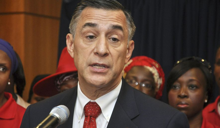 FILE - This Tuesday, Aug. 4, 2015 file photo U.S. Rep. Darrell Issa speaks during a news conference at the U.S embassy in Abuja Nigeria. Republican Issa, the wealthiest member of Congress with more than $250 million, rarely spent a penny on television ads or yard signs as he cruised to victory in past elections. Not this time. The eight-term lawmaker and chief antagonist of President Barack Obama and Democrat Hillary Clinton faces a tough challenge from Marine-turned-lawyer Doug Applegate. (AP Photo/Olamikan Gbemiga, File)