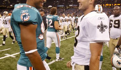 FILE--In this Sept. 3, 2009, file photo, Miami Dolphins linebacker Jason Taylor, left, and New Orleans Saints quarterback Joey Harrington talk after an NFL preseason game between the Miami Dolphins and New Orleans Saints in the Louisiana Superdome in New Orleans.  Harrington, the former Oregon Ducks quarterback and NFL player plans to open a restaurant in the Pearl District in downtown Portland, Ore., with three percent of the restaurant's profits going toward Harrington's charitable foundation, the Harrington Family Foundation, which provides scholarships for Oregon students who stay in-state for secondary education.(AP Photo/Sean Gardner)