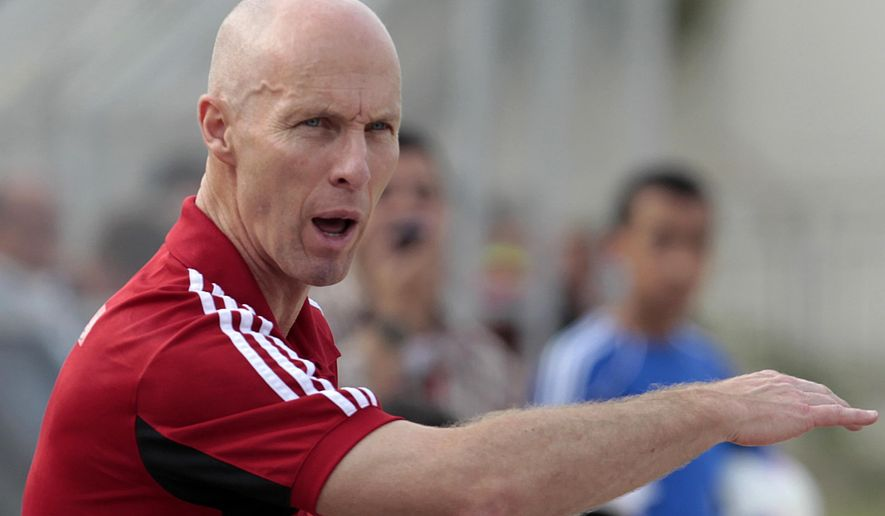 FILE - In this Friday May 11, 2012 file photo, Egypt's coach Bob Bradley from the U.S. gestures during a friendly soccer match between the Lebanese and Egyptian national teams, in the northern port city of Tripoli, Lebanon. Bob Bradley has become the first American manager of a Premier League club after being hired by Swansea City while announcing on Monday Oct. 3, 2016 it had fired Francesco Guidolin. (AP Photo/Hussein Malla, File)