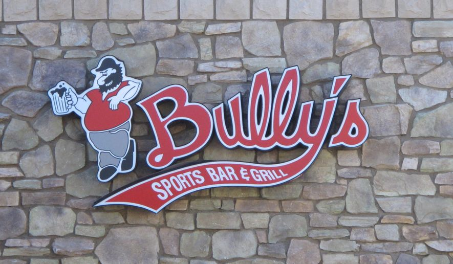 FILE--In this Feb. 24, 2015, file photo, the logo sign for a Bully's Sports Bar & Grill is shown in east Sparks, Nev.  Bully's Sports Bar & Grill has agreed to pay $375,000 in back wages to settle part of a class-action lawsuit with 15 cooks who accused the oldest sports bar chain in northern Nevada of denying them overtime pay in violation of federal labor laws. (AP Photo/Scott Sonner, file)
