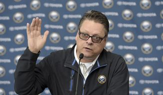 FILE - In this July 1, 2015, file photo, Buffalo Sabres general manager Tim Murray gestures during a press conference in Buffalo, N.Y. Encouraging as it might appear, Murray isn't overly impressed by the big jump Buffalo made in the standings last year. (AP Photo/Gary Wiepert, File)