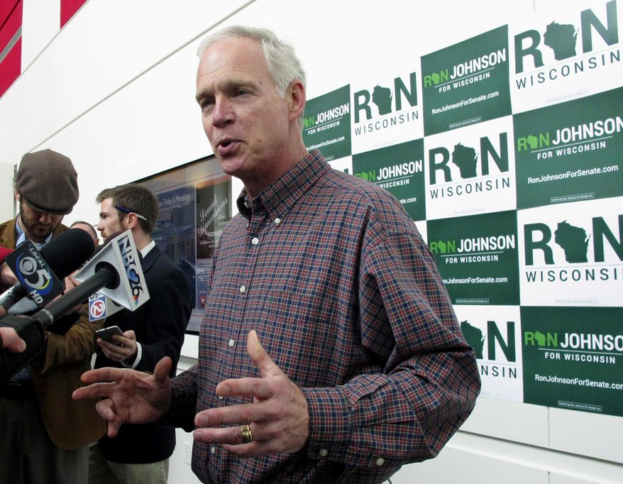 FILE - In this May 13, 2016, file photo, U.S. Sen. Ron Johnson, R-Wis., speaks with reporters in Green Bay, Wis. Johnson's challenger Democrat Russ Feingold continues to increase his fundraising haul as his rematch against Johnson nears. Feingold reported Monday, Oct. 3, 2016 that he had raised $5.2 million for the tree-month period ending in September. Johnson has yet to release his latest fundraising numbers. They aren't due to be reported until Oct. 27. (AP Photo/Scott Bauer, File)