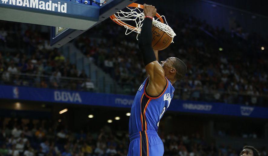 Oklahoma City Thunder guard Russell Westbrook dunks during a NBA Global Games basketball match between Real Madrid and Oklahoma City Thunder in Madrid, Spain Monday Oct. 3, 2016. (AP Photo/Daniel Ochoa de Olza)