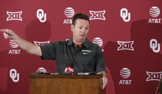 Oklahoma head coach Bob Stoops gestures as he speaks during an NCAA college football news conference in Norman, Okla., Monday, Oct. 3, 2016. This year's Texas-Oklahoma game is extra important for the coaches. Oklahoma's Bob Stoops and Texas' Charlie Strong have been criticized for their teams' less than desirable starts to the season. (AP Photo/Sue Ogrocki)