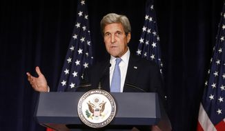 FILE - In this Sept. 22, 2016 file photo, Secretary of State John Kerry speaks in New York. The State Department says the U.S. is suspending bilateral contacts with Russia over Syria. That comes after last week's threat by Kerry to suspend contacts amid new attacks on the city of Aleppo. (AP Photo/Jason DeCrow, File)