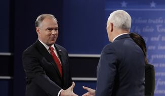 Republican vice-presidential nominee Gov. Mike Pence, right, shakes hands with Democratic vice-presidential nominee Sen. Tim Kaine during the vice-presidential debate at Longwood University in Farmville, Va., Tuesday, Oct. 4, 2016.(AP Photo/Julio Cortez)