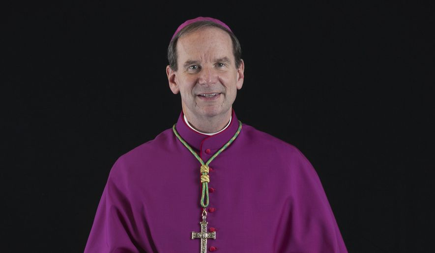 This photo provided by the Diocese of Raleigh, N.C., shows Michael Burbidge, who will lead the Catholic Diocese of Arlington, Va., the church announced Tuesday, Oct. 4, 2016.  (Paul Tomas/Diocese of Raleigh, N.C. via AP)