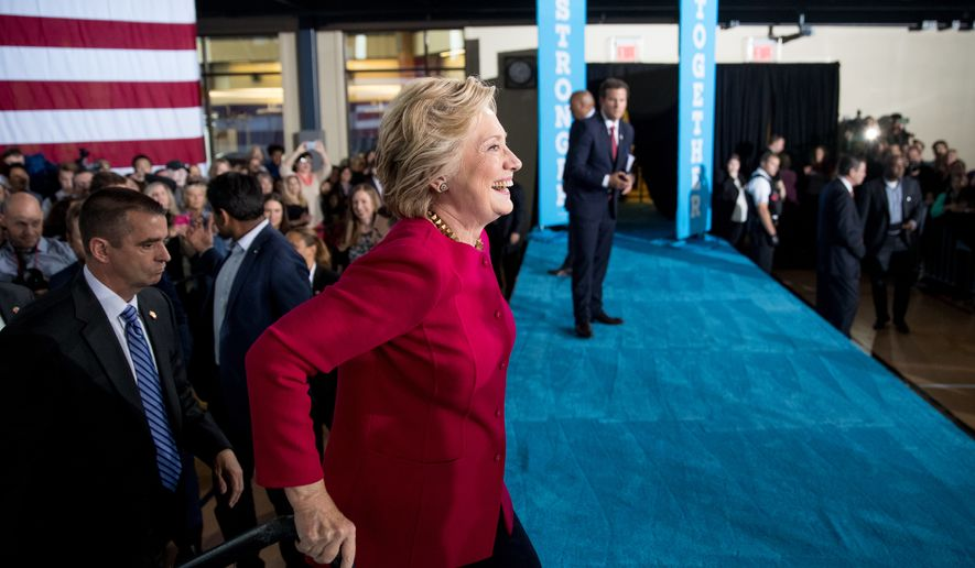 Democratic presidential candidate Hillary Clinton crosses the stage to greet members of the audience at a town hall at the Haverford Community Recreation and Environmental Center in Haverford, Pa., Tuesday, Oct. 4, 2016. (AP Photo/Andrew Harnik)