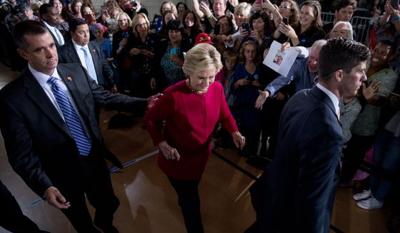 Democratic presidential candidate Hillary Clinton accompanied by members of the Secret Service, walks to greet members of the audience at a town hall at the Haverford Community Recreation and Environmental Center in Haverford, Pa., Tuesday, Oct. 4, 2016. (AP Photo/Andrew Harnik)