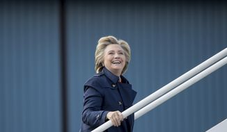 Democratic presidential candidate Hillary Clinton boards her campaign plane in White Plains, N.Y., Tuesday, Oct. 4, 2016, to travel to Philadelphia. Clinton is scheduled to attend rallies in Haverford, Pa. and Harrisburg, Pa. (AP Photo/Andrew Harnik)