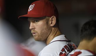 Washington Nationals' Stephen Strasburg looks on before a baseball game against the Arizona Diamondbacks, Tuesday, Sept. 27, 2016, in Washington. (AP Photo/Nick Wass)