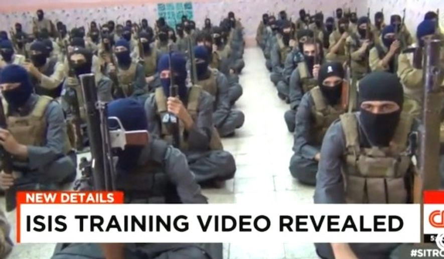 Members of the Islamic State group take part in a training session. (CNN screenshot)