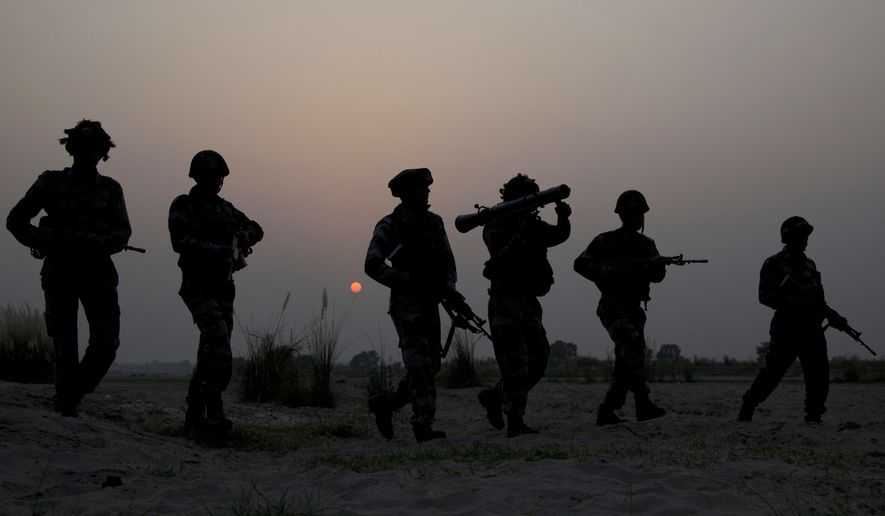 Indian army soldiers patrol near the highly militarized Line of Control dividing Kashmir between India and Pakistan, in Pallanwal sector, about 75 kilometers from Jammu, India, Tuesday, Oct. 4, 2016. Pakistan and India traded fresh accusations of cross-border fire in Kashmir on Tuesday, a day after top officials discussed ways of de-escalating tensions over the disputed Himalayan region. (AP Photo/Channi Anand)