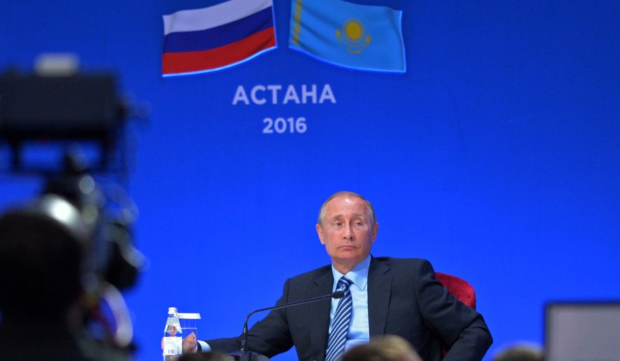 Russian President Vladimir Putin attends a business forum in Astana, Kazakhstan, Tuesday, Oct. 4, 2016. (Alexei Druzhinin/Sputnik, Kremlin Pool Photo via AP)