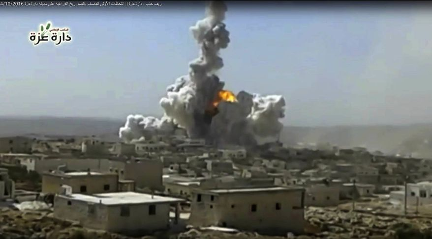 In this still image taken from video footage provided by the Daret Izza Media Office, an anti-government activist group, which has been authenticated based on its contents and other AP reporting, a big blast is seen at the edge of the city accompanied by a large plume of smoke and debris rising from the skyline, Daret Izza, Syria, Tuesday, Oct. 4, 2016. Activists say the explosion was caused by a thermobaric rocket launched by forces loyal to the Syrian government. (Daret Izza Media Office via AP)