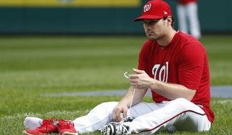 Washington Nationals second baseman Daniel Murphy changes his shoes during baseball batting practice at Nationals Park, Tuesday, Oct. 4, 2016, in Washington. The Nationals host the Los Angeles Dodgers in Game 1 of the National League Division Series on Friday. AP Photo/Alex Brandon)