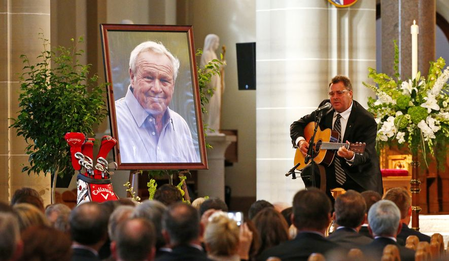 Country artist Vince Gill performs during a memorial service for golfer Arnold Palmer in the Basilica at St. Vincent's College in Latrobe, Pa., Tuesday, Oct. 4, 2016. (AP Photo/Gene J. Puskar)