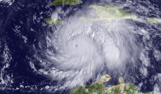 The GOES East satellite image provided by the National Oceanic and Atmospheric Administration (NOAA) and taken Monday, Oct. 3, 2016, at 9:15 a.m. EDT, shows Hurricane Matthew about 220 miles southeast of Kingston, Jamaica. Hurricane Matthew roared across the southwestern tip of Haiti with 145 mph winds Tuesday, Oct. 4, 2016, uprooting trees and tearing roofs from homes in a largely rural corner of the impoverished country as the storm headed north toward Cuba and the east coast of Florida. (NOAA via AP)