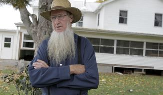 FILE - In this Oct. 10, 2011, file photo, Samuel Mullet Sr. stands in front of his home in Bergholz, Ohio. The leader of a breakaway group accused in hair- and beard-cutting attacks on fellow Amish in 2011, Samuel Mullet Sr., currently in federal prison in Elkton, Ohio, and two of the 15 followers sentenced in the case have asked for a U.S. Supreme Court review, in a petition filed in September 2016. (AP Photo/Amy Sancetta, File)