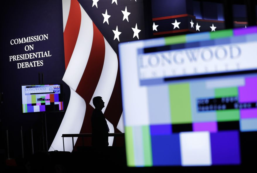 An official stands on stage during preparations for the vice-presidential debate between Republican vice-presidential nominee Gov. Mike Pence and Democratic vice-presidential nominee Sen. Tim Kaine in at Longwood University in Farmville, Va., Monday, Oct. 3, 2016.(AP Photo/AP Photo/Patrick Semansky)