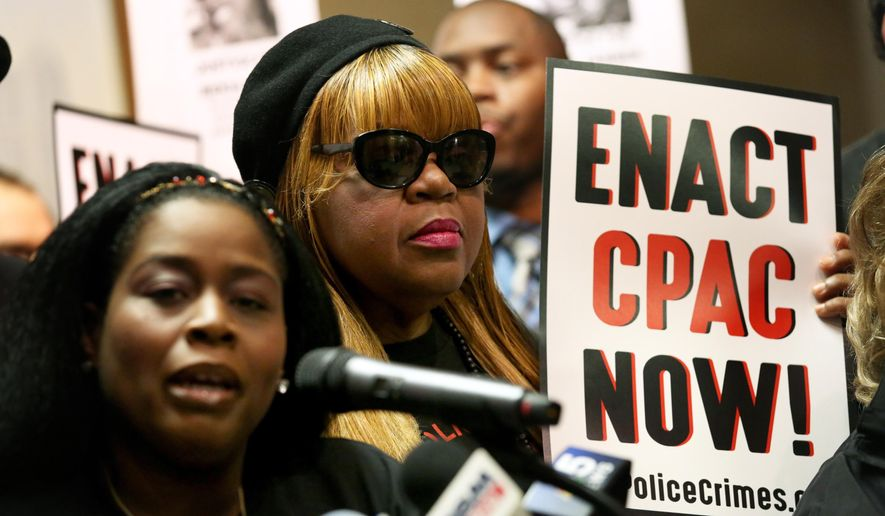 The Rev. Catherine Brown, left, speaks in favor of the Chicago Police Accountability Council (CPAC) at City Hall as the Public Safety Committee gets ready to vote on COPA, a new police oversight board, Monday, Oct. 4, 2016, in Chicago. Various groups rallied and protested at City Hall as the Budget and Public Safety committees met to discuss among many other items, the enactment of COPA the new police oversight committee  (Nancy Stone/ Chicago Tribune via AP)  (Nancy Stone/ Chicago Tribune via AP)