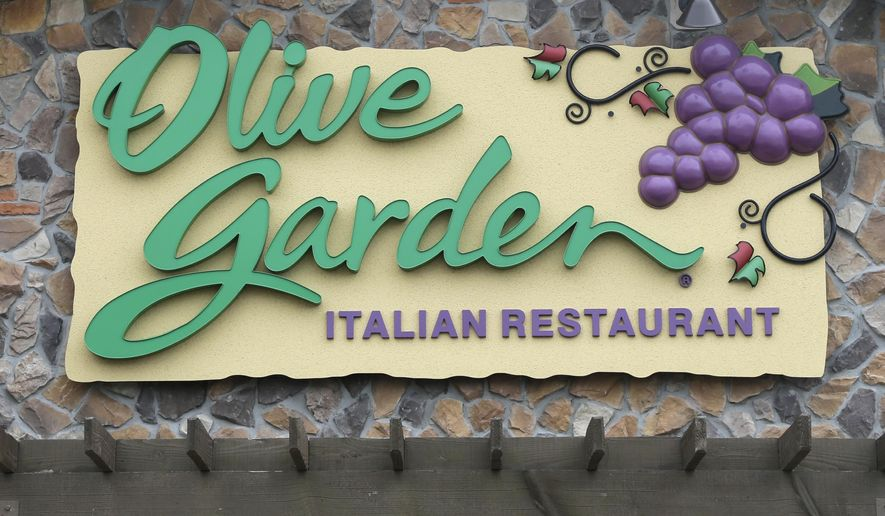 This Monday, June 27, 2016, photo shows an Olive Garden restaurant, a Darden brand, in Methuen, Mass. Darden reports financial results Tuesday, Oct. 4, 2016. (AP Photo/Elise Amendola)