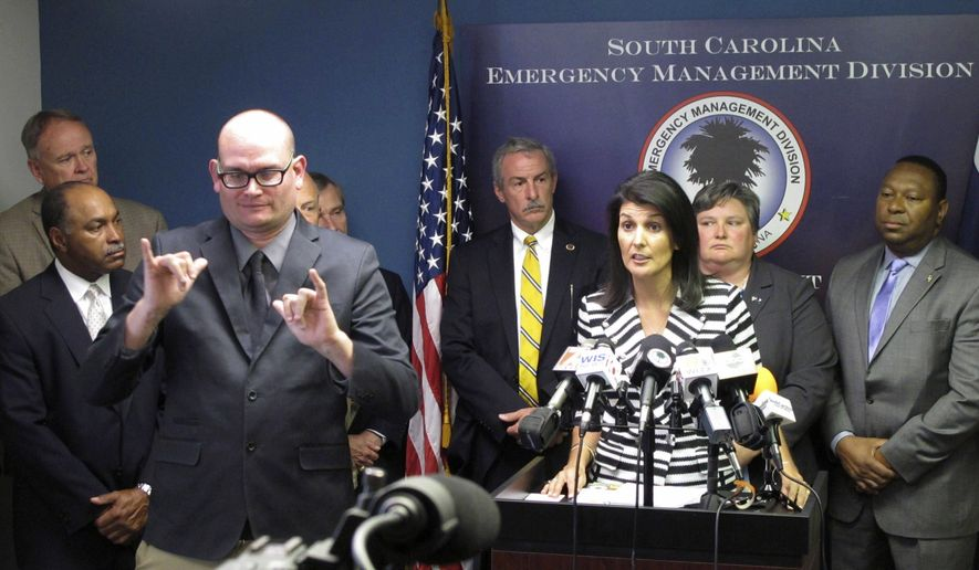 Gov. Nikki Haley announces that she plans to call for the evacuation of about 1 million people from South Carolina's coast as Hurricane Matthew threatens on Tuesday, Oct. 4, 2016, at the South Carolina Emergency Management Division headquarters in Pine Ridge, S.C.  (AP Photo/Jeffrey Collins)