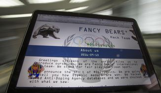"""FILE - A Wednesday, Sept. 14, 2016 file screenshot of the Fancy Bears website fancybear.net seen on a computes screen in Moscow, Russia. Somewhere in Russia, one imagines, computer hackers are congratulating themselves on a well-executed con. By stealing and then publishing the private medical files of more than 100 international athletes from a World Anti-Doping Agency database, the self-described """"Fancy Bears hack team"""" diverted attention from Russia's systemic abuse of banned performance-enhancing drugs in sport, the biggest doping scandal since East German officials fed powerful steroids to teenagers during the Cold War. (AP Photo/Alexander Zemlianichenko, File)"""