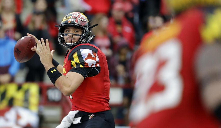 FILE - In this Saturday, Oct. 1, 2016, file photo, Maryland quarterback Perry Hills throws to a receiver in the first half of an NCAA college football game against Purdue in College Park, Md. Coming off a season in which he threw 13 interceptions, Hills has done a masterful job of running unbeaten Maryland's high-powered offense. (AP Photo/Patrick Semansky, File)