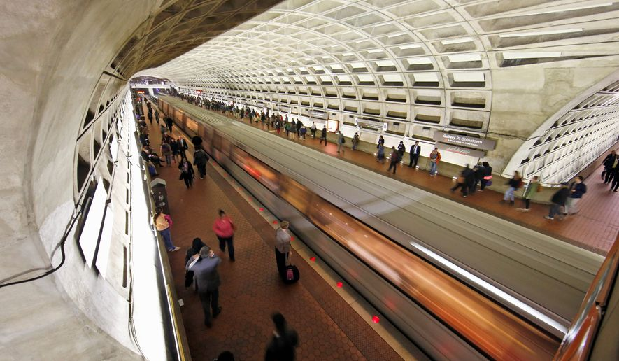 A Metro train departs the Gallery Place-Chinatown Metro station Tuesday, March 15, 2016 in Washington. The rail system that serves the nation's capital and its Virginia and Maryland suburbs will shut down for a full day Wednesday after a fire near one of the system's tunnels, the system's head announced. (AP Photo/Alex Brandon)