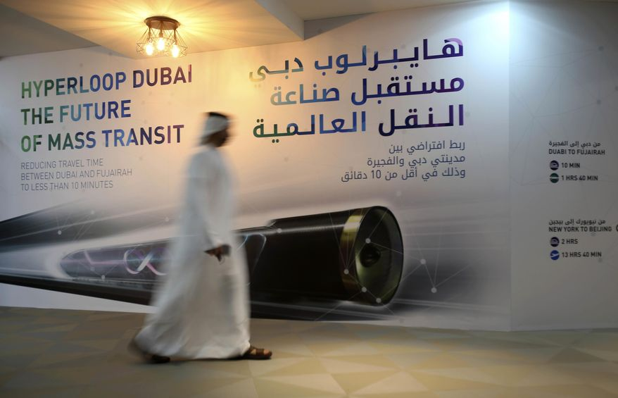 An Emirati man passes by a poster presenting Hyperloop Dubai, The Future of Mass Transit at the Dubai Future Accelerators in Dubai, United Arab Emirates, Tuesday, Oct. 4, 2016. A competition designing a system of tubes to zip people past Dubai's skyscraper-studded skyline near the speed of sound is more than a pipe dream for this desert sheikdom long fascinated with the future _ and with being the first ones there. (AP Photo/Kamran Jebreili)