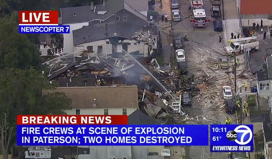 In this frame from video provided by WABC-TV, firefighters work at the scene after an explosion in Paterson, N.J., Tuesday, Oct. 4, 2016. Multiple houses were destroyed in an explosion that occurred after neighbors reported the smell of gas and firefighters arrived to investigate. (WABC-TV via AP)