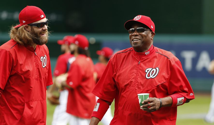 Washington Nationals left fielder Jayson Werth, left, and manager Dusty Baker share a laugh during baseball batting practice at Nationals Park, Tuesday, Oct. 4, 2016, in Washington. The Nationals host the Los Angeles Dodgers in Game 1 of the National League Division Series on Friday. AP Photo/Alex Brandon) **FILE**