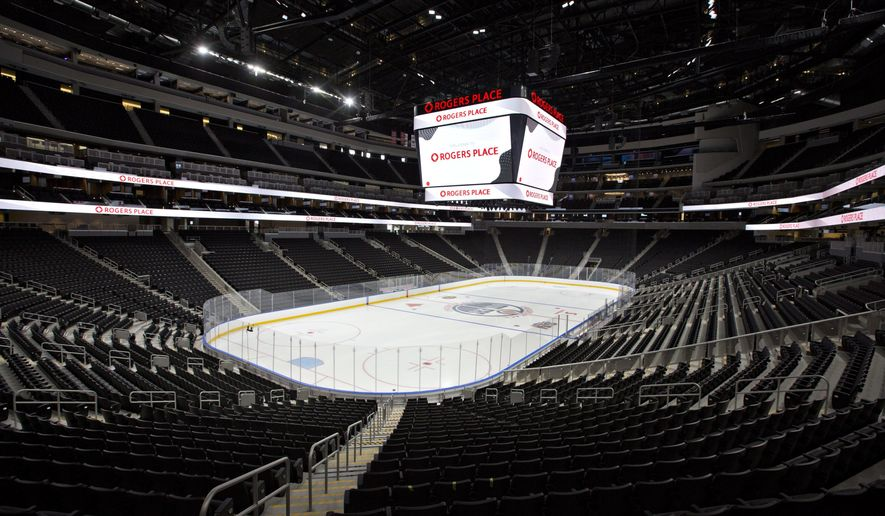 FILE - In this Sept. 8, 2016, file photo, Rogers Place, the new home of the Edmonton Oilers NHL hockey team, is viewed in Edmonton, Alberta. Opening the new arena signals a fresh start and a new era for the Oilers. (Jason Franson/The Canadian Press via AP, File)