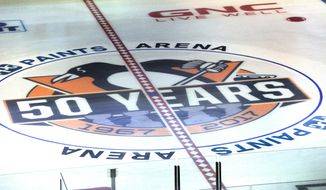 The new center ice logo is displayed with the new arena name PPG Paints Arena, formerly the Consol Energy Center, the home of the Pittsburgh Penguins NHL hockey club, Tuesday, Oct. 4, 2016, in Pittsburgh. The move comes as Pittsburgh-based PPG increases its efforts in the retail paint business and Consol, based in suburban Cecil Township, has struggled with financial losses while transitioning from a coal-based firm to one fueled by the future of natural gas. (Pam Panchak/Pittsburgh Post-Gazette via AP)