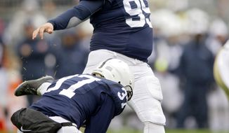 FILE - In this Oct. 3, 2015, file photo, Penn State's Joey Julius kicks a field goal during an NCAA college football game against Army in State College, Pa. Joey Julius, the 258-pound redshirt sophomore,  disclosed in a Facebook post on Sunday, Oct. 2, 2016,  that he received treatment for an eating disorder this summer. (Abby Drey/Centre Daily Times via AP, File)