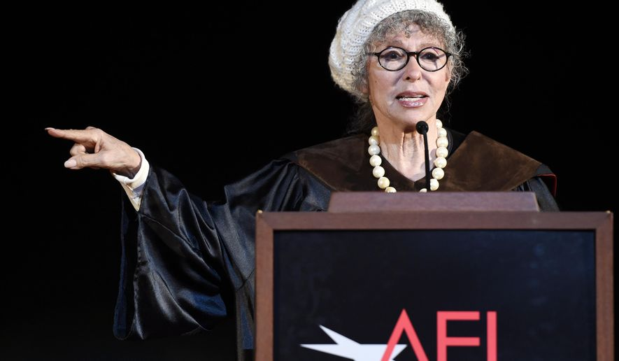 FILE - In this June 15, 2016 file photo, honoree Rita Moreno addresses the audience during the 2016 AFI Conservatory Commencement in Los Angeles. During a call with journalists organized by the organization People for the American Way, Moreno said on Tuesday, Oct. 4, that the best way to defeat Republican presidential candidate Donald Trump is to register to vote in order to keep him out of the White House. (Photo by Chris Pizzello/Invision/AP, File)