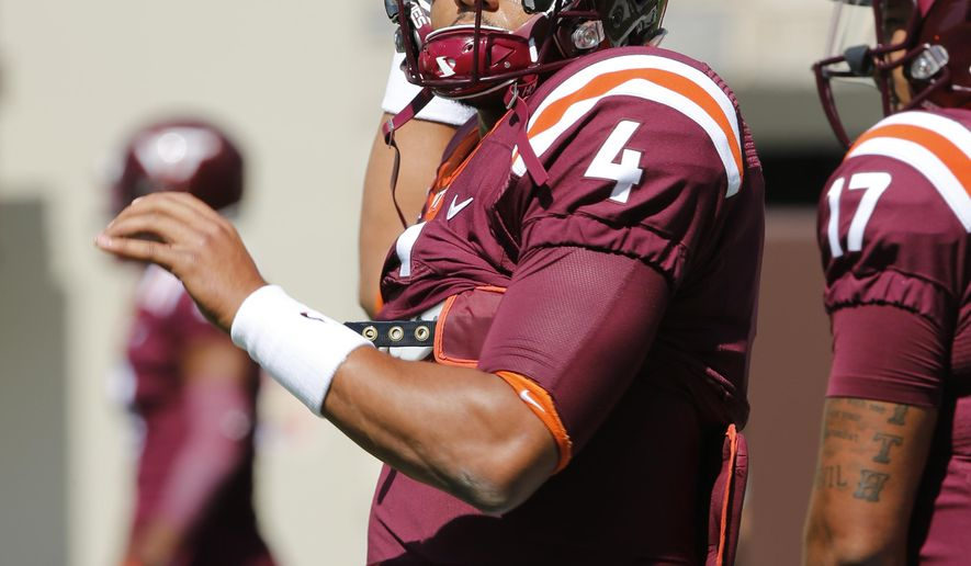 FILE - In this Sept. 3, 2016, file photo, Virginia Tech quarterback Jerod Evans (4) tosses a pass during warm ups prior to the start of an NCAA college football game in Blacksburg, Va. The Hokies returned to the Top 25 this week at number 25, and face a test as to whether they belong when they travel to North Carolina to face the No. 17 Tar Heels on Saturday. (AP Photo/Steve Helber, File)