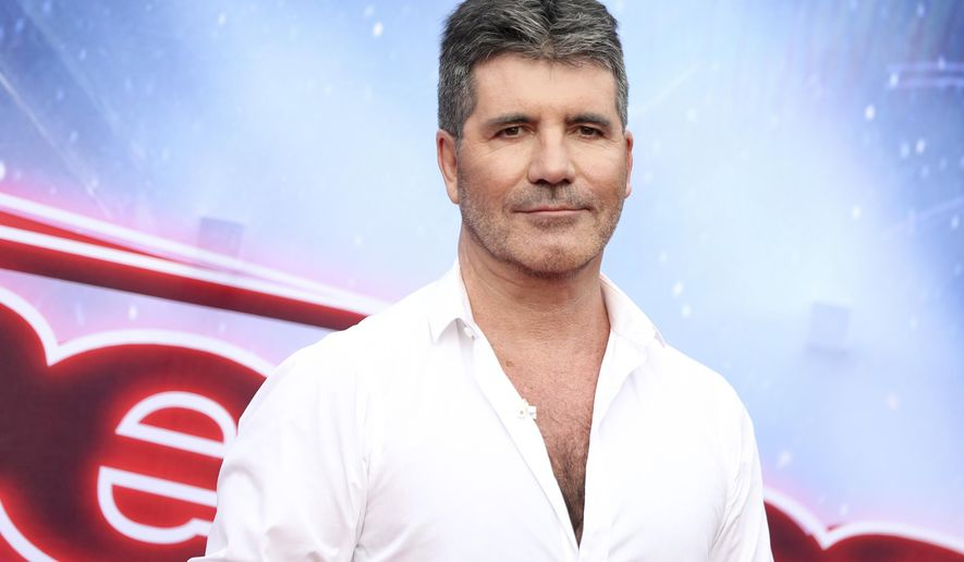 """FILE - In this March 3, 2016 file photo, Simon Cowell arrives at the """"America's Got Talent"""" Season 11 Red Carpet Kickoff in Pasadena, Calif. Cowell will serve as judge on """"America's Got Talent"""" through 2019. NBC said Tuesday, Oct. 4, that Cowell has signed on as part of the talent show's judging panel for three more seasons. (Photo by Rich Fury/Invision/AP, File)"""
