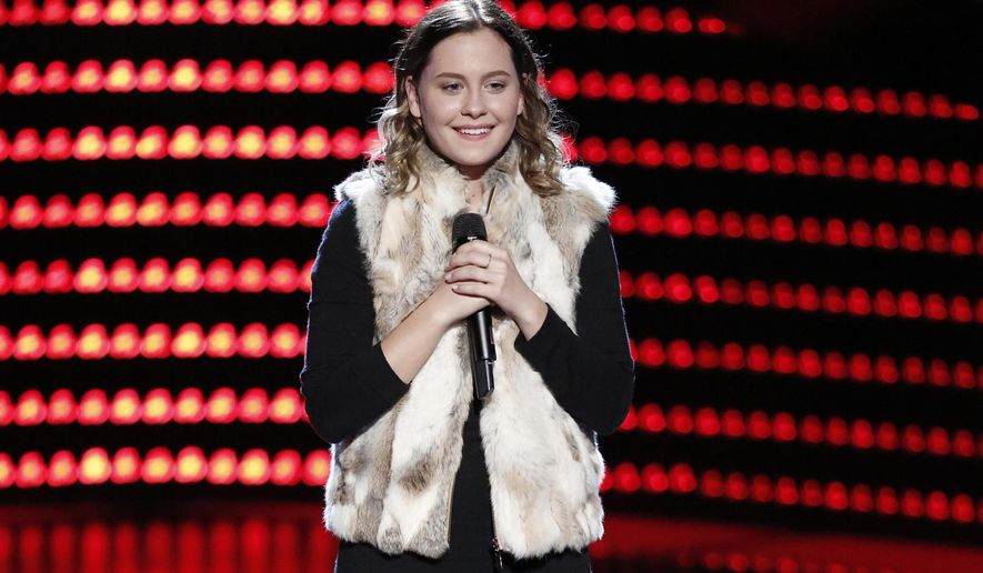 "In this image released by NBC, Natasha Bure appears on the singing competition series, ""The Voice,"" in an episode airing Monday, Oct. 3, 2016. Bure is the 18-year-old daughter of ""Fuller House"" star Candace Cameron Bure and was selected by judge Adam Levine during her rendition of Elvis Presley's ""Can't Help Falling in Love"" on Monday's show. (Tyler Golden/NBC via AP)"